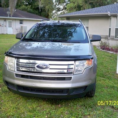 2008 Ford Edge with 110,305 miles. The next 28 photos are of the vehicle from all sides and interior.