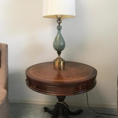Leather top brass feet accent table 30 inch diameter January mahogany 27 foot tall one drawer