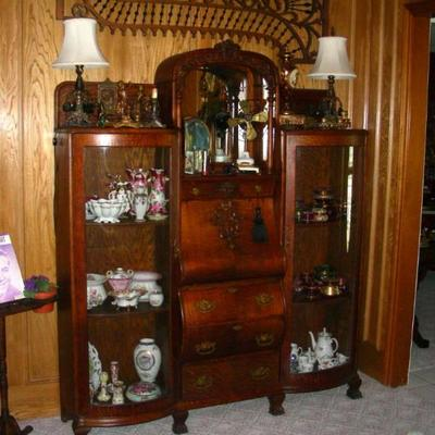 Oak side-by-side, filled with ceramics and glass dresser jars.