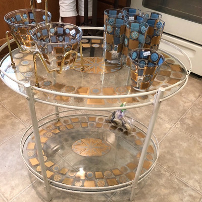 Mid-Century Atomic Bar cart and Glassware.