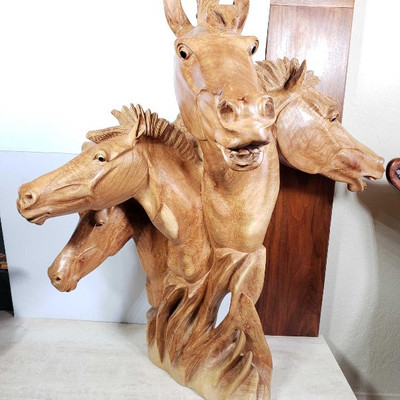 # 126  Hand Carved Wooden Horse Staute 4 heads of horses are Hand carved from one piece of Island Mahogany wood. Heavy and solid piece....