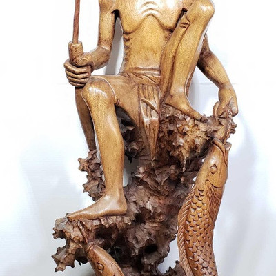134:  Hand Carved from Island Mahogany Wooden Fisherman with his catch. Hand carved from one piece of Island Mahogany wood, Fisherman...