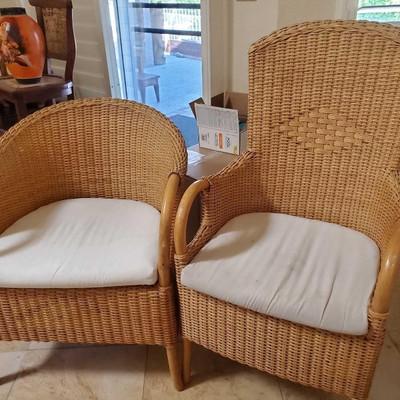 # 72  Two Wicker Patio Chairs Basket weaved wood wicker chairs. Measure approx 38