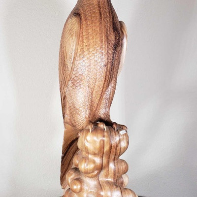 # 152 Hand Carved Wooden Bird Measures approximately 39