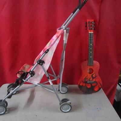 Folding Child Stroller and Kids Guitar