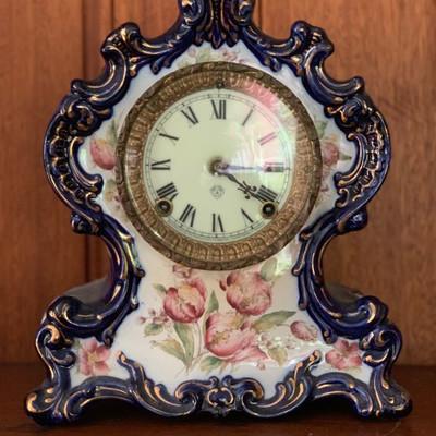 Ansonia antique clock on WACO porcelain case