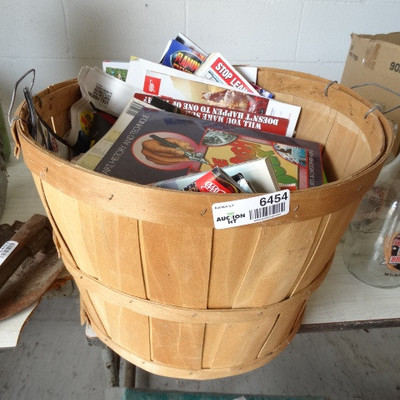 Apple basket with magazines.