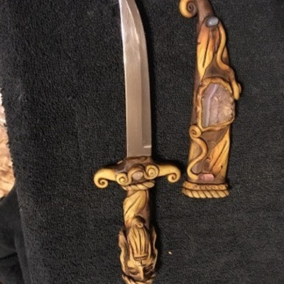 Daggar with Carved Vagabond Handle with Inlaid Sto ...