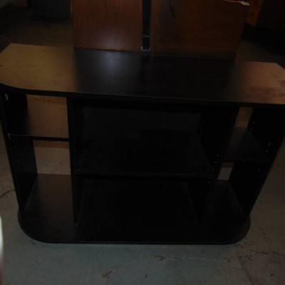 Black entertainment center with shelves