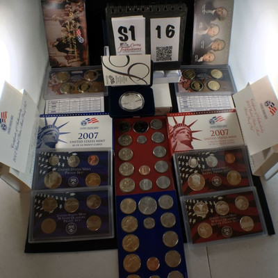 1) 2007 American Eagle One Ounce silver proof coin in hard case inside blue velvet box.  2) 2007 Presidential One dollar coin set of 4 in...