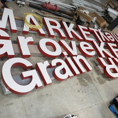 Oak Grove Grain Valley Market signs
