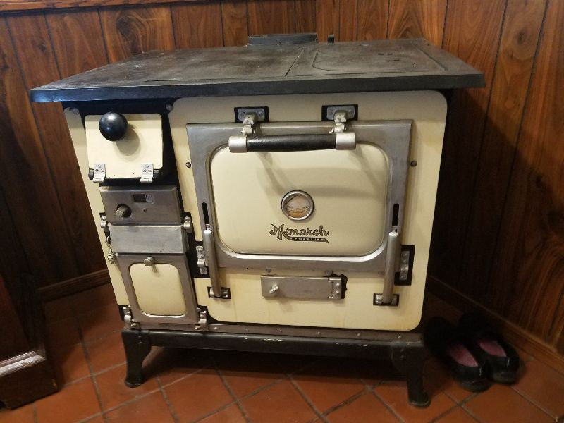 Black and Cream Monarch Wood Burning stove. $750 or best offer. Works great!