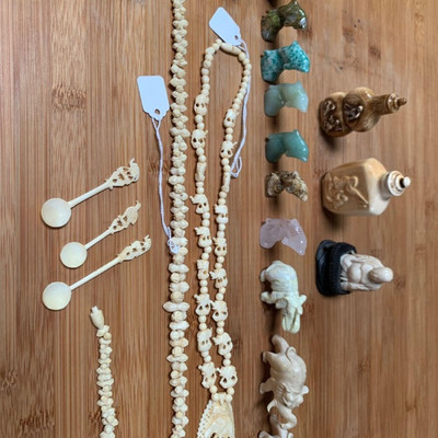 151: 	 Handmade jewelry, snuff bottles, figurines and trinkets Amazing hand designed carved jewelry, bone snuff bottles with hand carved...