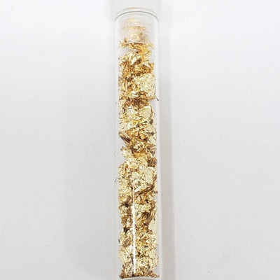 175: 	 Vial of 24K gold leaf flakes This is an appx 3mil vial filled with gold leaf flakes. Plastic snap top with fine 24k gold often...