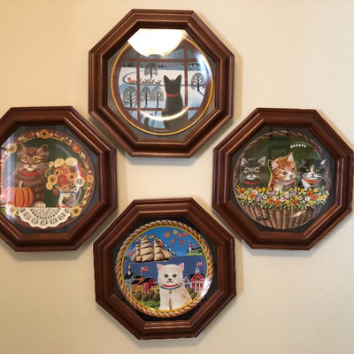 Collectible framed cat plates.