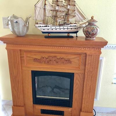 Fireplace w/Oak Finish and Decorative Wood Detail- $65 - (38W  10D  40H)