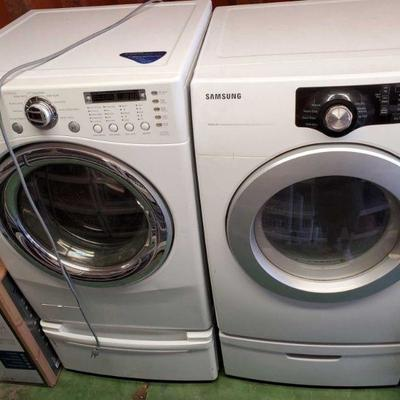 """6951: LG Tromm Front Load Steam Washer and Samsung Sensor Dry Front Load Dryer Featured here is an LG Tromm Steam 24"""" front loading..."""