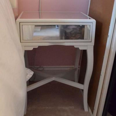 One of a pair of mirrored bedside tables