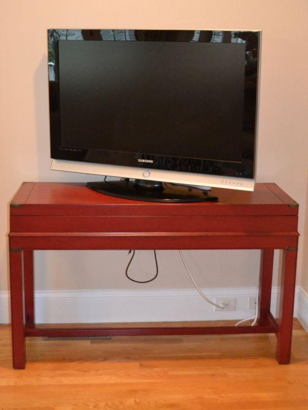 "One of a pair of chest-on-stand console tables and 40"" Samsung TV"