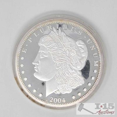 700: 2004 One Troy Pound Morgan Silver Dollar .999 Fine Silver 2004 One Troy Pound Morgan Silver Dollar .999 Fine Silver