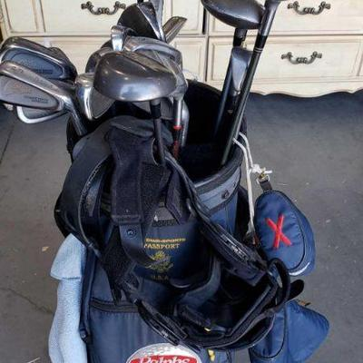 212: Senior PGA Tour Golf Bag w/ Approx. 20 Golf Clubs and Breg Knee Brace Senior PGA Tour Golf Bag w/ Approx. 20 Golf Clubs and Breg...