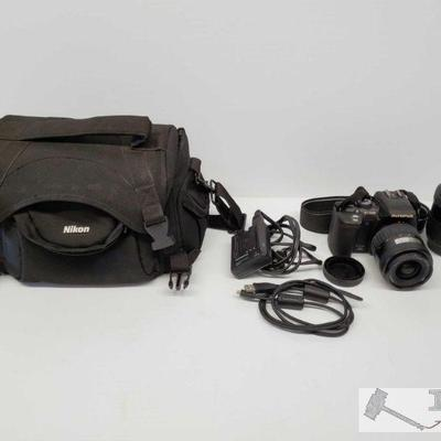 Olympus E-500 Camera w/ Lens, Battery Charger and Nikon Carry Case Olympus E-500 Camera w/ Lens, Battery Charger and Nikon Carry Case...