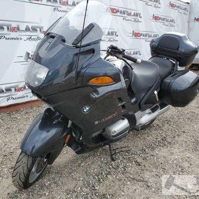 65: 	 2000 BMW R1100RT, Black Bike has front adjustable windshield, hand controls for radio, removable saddle bags and back storage bin....