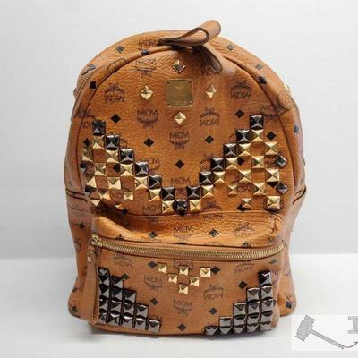 Nonauthenticated, MCM Leather BackPack Brown Leather MCM Backpack w/ Metal Fixtures and multi pockets