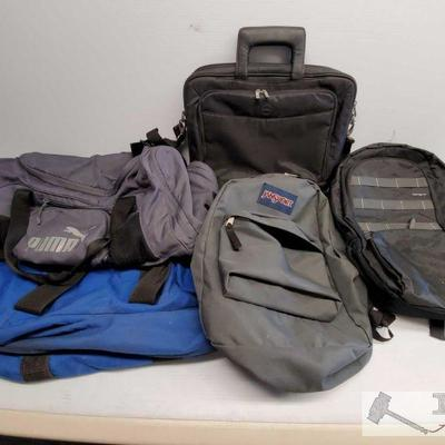 Five Various Sized Bags One Dell Computer case bag, Two Sports duffel bags(one PUMA brand), one Jansport Grey and one targus backpack