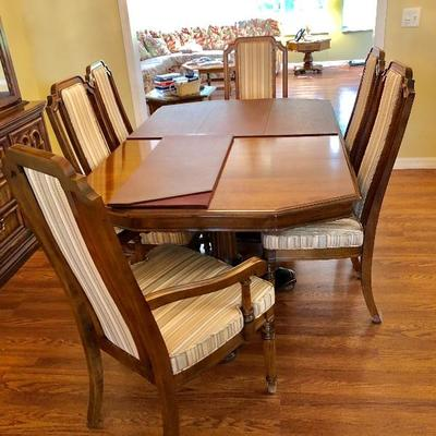 Ethan Allen Fruitwood Dining Table with 8 Chairs and 2 Leaves and tabletop protective pads - $525 (41W  65L w/o leaves)