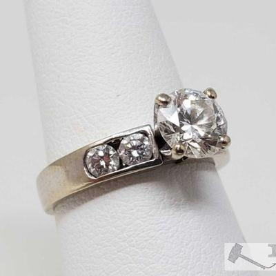 103:  18k Gold 1.25ct Round Cut Diamond Channel Set Ring, 4.2g Weighs approx 4.2g, approx size 6.5  Center Diamond Approx 1.25ct