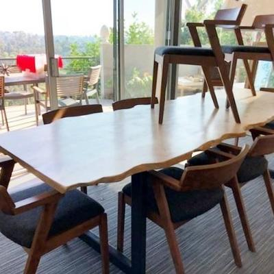 One of A Kind Custom dining table by Arbor Exchange in Pasadena from a downed tree. Chairs from Article One.