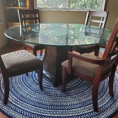 Dining table  with 4 chairs 4 additional chairs available