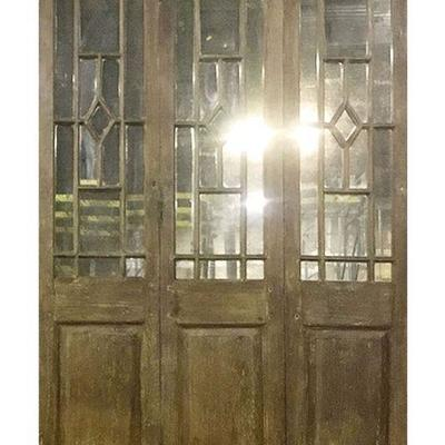 Dozens of teak panels and room dividers, most with mirror backs