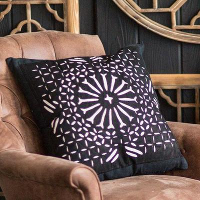 Various pillows, fabrics, and other textiles including scarves and vintage linens.