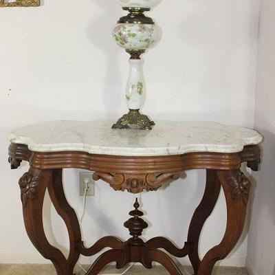 "Victorian White Marble Top Center Table, 38 1/2"" W x 25 1/2 D x 28"" H.  Also shown with Hand Painted victorian Oil Lamp, 29"" H"
