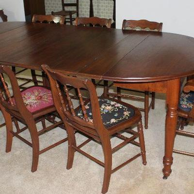 "Antique Round/Oval Table with 6 leaves on Turned legs and original Casters 94"" L x 45"" W x 30"" H shown with 8 (7 Side and 1 Arm) Chairs..."
