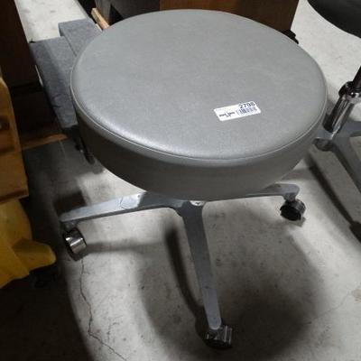 Adjustable height padded stool on wheels