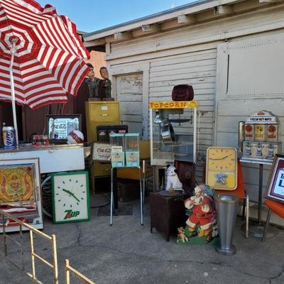 Fabulous is forties nut machine, light up camel clock.  vending cart chalkware Laurel and Hardy  lots of fun