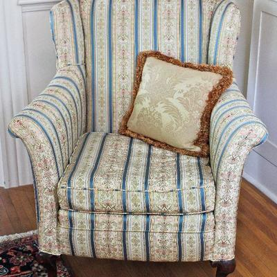 a variety of upholstered arm chairs