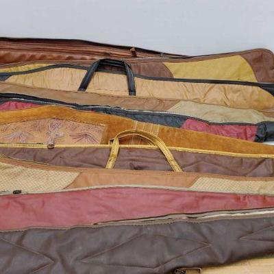 883: 10 Leather Rifle Cases Measures range from 42