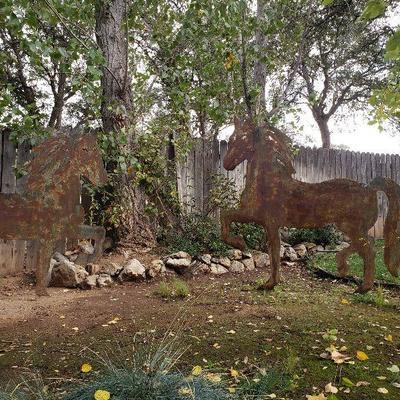 Pair of 6 ft cut metal horses.