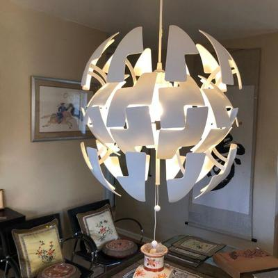 Contemporary transforming lighting fixture