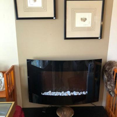 Electric fireplace/heater with hanging bracket (included).