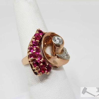 14k Gold Diamond and Ruby Ring,7.7 This Beautiful 14k Gold Diamond ruby ring weighs approximately 7.7g and the size is approximately 7....