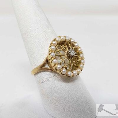 14k Gold Diamond Pearl Ring, 5.4 This rings is a 14k diamonds gold pearl, it weighs approximately 5.4g and is sized at approximately 8.5...