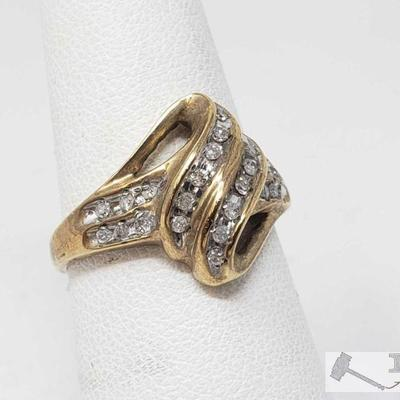 10k Gold Diamond Channel Setting Ring, 3.4 This Beautiful 10k Gold Diamond Channel Setting Ring is approximately a Size 7 and weighs...