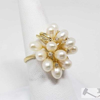 14k Pearl and Diamond Ring, 6.7 This 14k Pearl and diamond ring weighs approximately 6.7g and is the size is approximately 8.5 Metal...