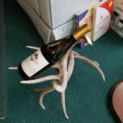 This is an empty bottle to show that this is an antler wine holder.