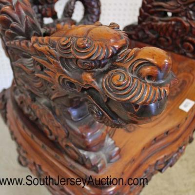 Early Asian Highly Carved and Ornate Dragon Head Hard Wood Arm Chair  Auction Estimate $300-$600 – Located Inside